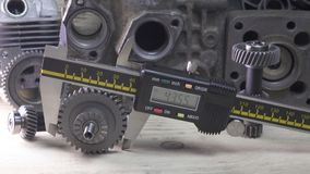 Measurement of the details by a digital caliper, Dolly shot.  stock footage