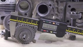 Measurement of the details by a digital caliper, Dolly shot.  stock video
