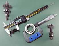 Measurement of the details by a digital caliper and a mechanical micrometer.  stock image