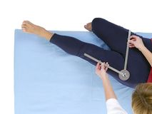 Measurement of hip joint adduction Stock Photo