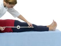 Measurement of hip joint flexion Stock Photography