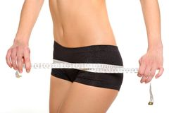 Measurement of the ideal figure of a young girl Stock Image