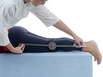 Measurement of knee joint flexion Stock Image