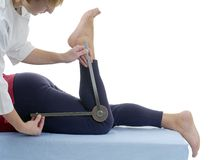 Measurement of knee joint flexion Stock Images