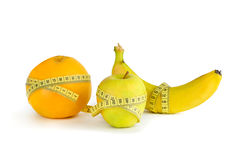 Measurement of orange, apple and banana Stock Photography