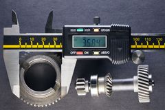 Measurement parameters of gears, details by digital micrometer.  royalty free stock photo