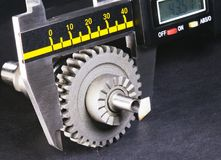 Measurement  parameters of gears, details by digital micrometer Royalty Free Stock Photography