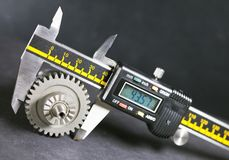 Measurement  parameters of gears, details by digital micrometer Stock Photos