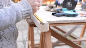 Measurement process for a little wooden chair stock video footage