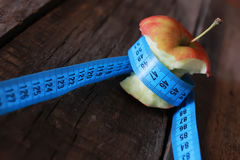 Measurement red bitten apple Stock Photography