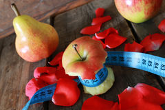 Measurement red bitten apple Royalty Free Stock Image