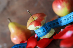 Measurement red bitten apple Royalty Free Stock Photo
