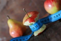 Measurement red bitten apple stock images