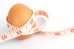 Measurement tape and egg Royalty Free Stock Photos