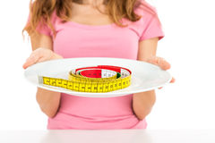 Measurement tape on a plate Royalty Free Stock Photography