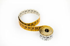 Measurement tape. White and yellow measurement tape royalty free stock images
