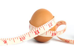 Measurement Tape Wrapped Around The Egg Royalty Free Stock Image