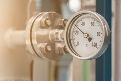 Measurement. Temperature gauge in petrochemical plant Royalty Free Stock Images