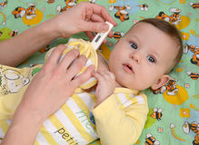 Measurement of temperature to the sick baby electronic thermometer Royalty Free Stock Photography