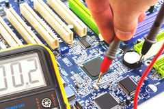 Measurement and testing to the PC motherboard. Basic measuring and testing the motherboard to the PC by measuring instrument Royalty Free Stock Photography