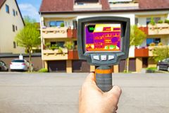 Measurement with thermographic camera. Measurement on a house with a thermal imager Stock Photo