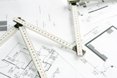 Measurement tool over blueprints Royalty Free Stock Photography