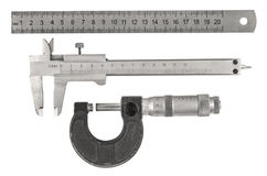 Measurement tools. Three old measurement tools - ruler, caliper and micrometer on white background royalty free stock images