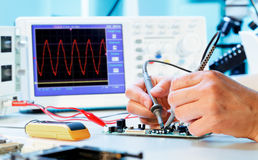 Measurement of a waveform. With an oscilloscope stock photography