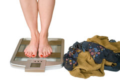 Measurement of weight to within gram. Girl on scales and take off clothes Stock Images