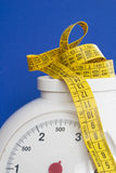 Measurements. Balance and centimeter Royalty Free Stock Photo