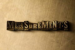 MEASUREMENTS - close-up of grungy vintage typeset word on metal backdrop Royalty Free Stock Image
