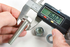 Measurements by a digital caliper in the master`s hand royalty free stock image
