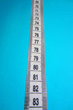 Measurements. Milestones and measurements on the blue background Stock Photos