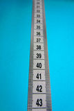 Measurements. Milestones and measurements on the blue background Royalty Free Stock Image