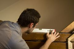 Measurements using spirit level. Royalty Free Stock Photo