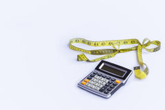 Measures. Calculator and tape measure. White background Stock Photo