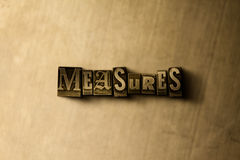 MEASURES - close-up of grungy vintage typeset word on metal backdrop Stock Photography