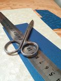 Measures for handicrafts. Scissors,  rule and beautiful sheets of cartons Royalty Free Stock Photo