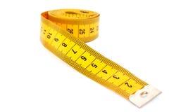 Measuretape. Yellow measuretape isolated on white background Stock Photography