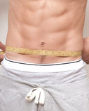 Measuring The Abdominals Royalty Free Stock Photos