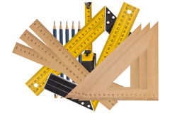 Measuring the angle and length. Metallic tool to measure right angle, triangle and wooden ruler, pencil and tape measure on a white background Stock Image