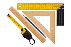 Measuring the angle and length. Metallic tool to measure right angle, triangle and wooden ruler, pencil and tape measure on a white background Stock Photos