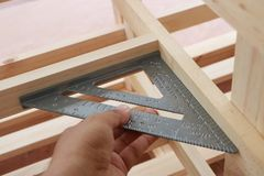 Measuring angle of wooden furniture Stock Photography