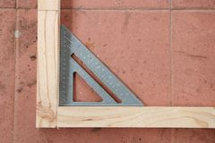 Measuring angle of wooden structure Royalty Free Stock Photo