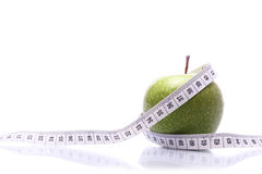 Measuring an apple Royalty Free Stock Photos