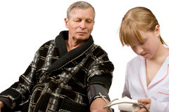 Measuring arterial pressure. Girl measuring arterial pressure to grandfather royalty free stock images