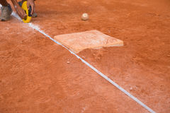 Measuring the base distance of baseball field Royalty Free Stock Image