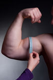 Measuring bicep Royalty Free Stock Photos