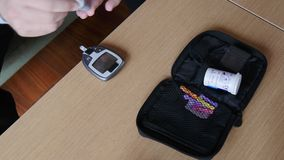 Measuring blood glucose, closeup. 4K. stock video