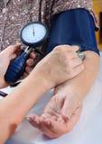 Measuring blood pressure Royalty Free Stock Image